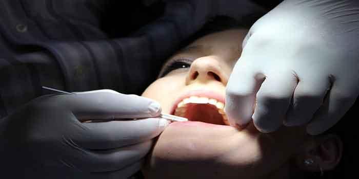 दांतों में संक्रमण के लक्षण
